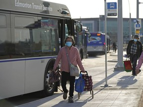 Transit riders at Edmonton Transit System's Mill Woods Transit Centre on Monday April 26, 2021. The city revamped the entire transit system on Sunday April 25, 2021.