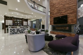 """Located in the city's prestigious Windermere Drive area, the 12,700-square foot """"Ariliya"""" showhome features a roof deck, a five-car garage, nine bathrooms, two kitchens, a home theatre, a workout room, a golf simulator and a built-in waterfall."""