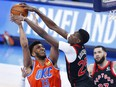 Oklahoma City Thunder center-forward Tony Bradley (13) is defended by Toronto Raptors forward Chris Boucher (25) at Chesapeake Energy Arena.
