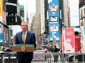 New York City Mayor Bill de Blasio speaks during the opening of the Broadway vaccination site amid the COVID-19 pandemic in New York City, April 12, 2021.