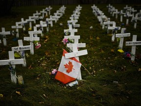Crosses are displayed in memory of the elderly who died from COVID-19 at the Camilla Care Community facility during the COVID-19 pandemic in Mississauga, Ont., on Thursday, November 19, 2020.