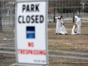 Crews work to clean up the site of the former homeless support camp Camp Pekiwewin, next to Re/Max Field, in Edmonton on April 1, 2021.