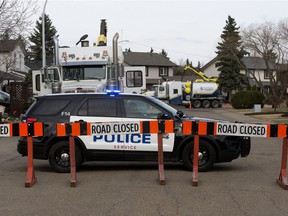 Police work at the scene of a fatal traffic collision near 122 Street and 143A Avenue, in Edmonton, Tuesday, April 27, 2021.