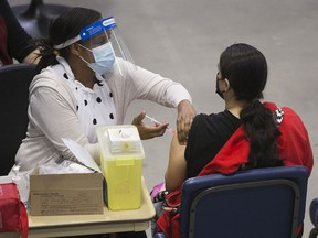 A nurse delivers a COVID-19 vaccination shot at the First Nations Vaccination Clinic at the River Cree Resort and Casino, near Edmonton Tuesday April 13, 2021. File photo.