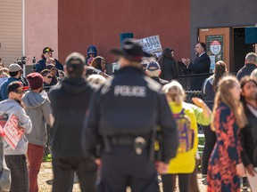 Pastor Arthur Pawlowski leads a hymn as hundreds gather outside Street Church in Southeast Calgary despite COVID-19 restrictions on Saturday, May 1, 2021.