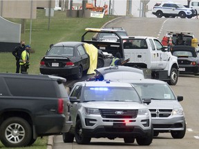 Police and emergency work at the scene of a fatal shooting along Baseline Road between Hwy. 21 and Clover Bar Road, in Sherwood Park Friday May 7, 2021. A 43-year-old man is facing a charge of murder.