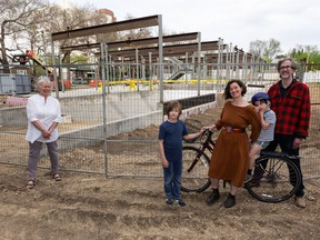 Co-housing community members (from left) Della Dennis, Max Moss, 9, Thea Moss, August Moss, 6, and Grant Stovel outside their under-construction Urban Green cohousing building at 10115 88 Ave.