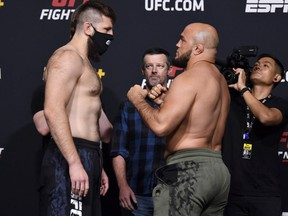 Tanner Boser of Canada and Ilir Latifi of Sweden face off during the UFC Fight Night weigh-in at UFC APEX on June 04, 2021 in Las Vegas, Nevada.