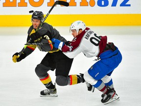 Vegas Golden Knights defenseman Brayden McNabb (3) eyes the puck while taking a check from Colorado Avalanche right wing Mikko Rantanen (96) during the first period of game four of the second round of the 2021 Stanley Cup Playoffs at T-Mobile Arena on June 6, 2021.