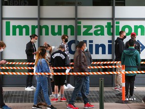 Calgarians line up to enter the COVID-19 vaccination clinic at the Telus Convention Centre on Saturday, May 22, 2021.