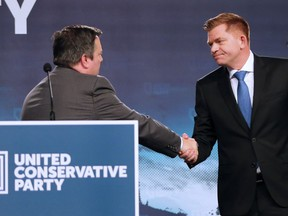 Jason Kenney, left, shakes hands with Brian Jean after Kenney was elected leader of the United Conservative Party in Calgary on Oct. 28, 2017.