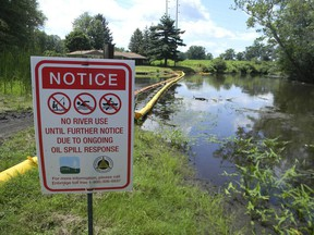 A sign at the confluence of Talmadge Creek and the Kalamazoo River warns residents of Marshall, Mich. On July 26, 2010, hundreds of thousands of gallons of oil from a ruptured pipeline operated by Enbridge Inc. spilled into the Kalamazoo. The current debate over Line 5 goes back to this disaster, says columnist Gerry Kruk.