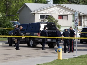 ASIRT and Edmonton police investigate the area on Sunday, June 6, 2021 after a man was shot and killed in a confrontation with police near 134 Avenue and 107 Street in Edmonton's Rosslyn neighbourhood  on Saturday night.