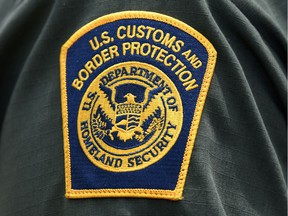 FILE PHOTO: A U.S. Customs and Border Protection patch is seen on the arm of a U.S. Border Patrol agent in Mission, Texas, U.S., July 1, 2019. REUTERS/Loren Elliott/File Photo ORG XMIT: FW1