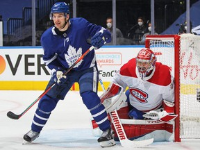 Carey Price #31 of the Montreal Canadiens watches for the puck around Zach Hyman #11 of the Toronto Maple Leafs in Game Five of the First Round of the 2021 Stanley Cup Playoffs at