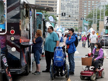 Edmontonians line up outside the Winston's Fish & Chips food truck during the opening day of Taste of Edmonton, Sir Winston Churchill Square Thursday July 22, 2021. Taste of Edmonton runs from July 22 to August 1. Photo by David Bloom