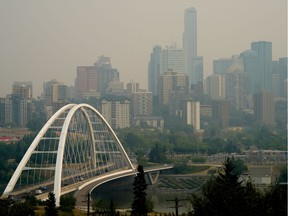 The downtown Edmonton skyline was shrouded in smoke from the wildfires in British Columbia on Thursday July 15, 2021. (PHOTO BY LARRY WONG/POSTMEDIA)