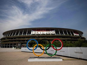 This picture shows the Olympic rings and Olympic Stadium in Tokyo on July 20, 2021, ahead of the Tokyo 2020 Olympic Games.