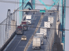 Traffic on the Ambassador Bridge, which connects Windsor, Ont., with Detroit, Michigan, on Tuesday, February 9, 2021.