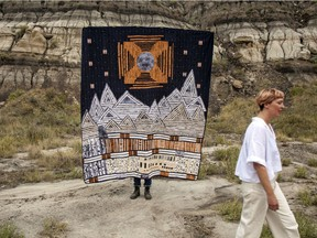 Linday Sutton walks in front of the quilt that started it all in the Badlands. Miruna Dragan photo.