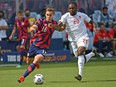 James Sands (No. 16) of the United States controls the ball against Ayo Akinola (No. 20) of Canada during the first half of the 2021 CONCACAF Gold Cup match at Children's Mercy Park on July 18, 2021 in Kansas City, Kansas. Canada will play the United States again in a FIFA World Cup qualifier on Sunday in Nashville.