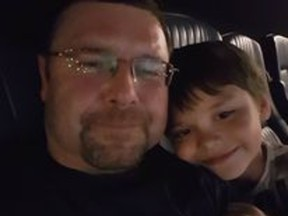 """Daniel Winston Robinson, seen with his son, died Aug. 30, 2021, after an """"altercation"""" at the Edmonton Remand Centre. Police have deemed the death non-criminal but Robinson's family continue to push for answers."""