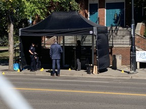 Edmonton homicide detectives investigate the scene of a suspicious death of a man in his 20s found at a bus stop around 3:30 a.m., Sept. 4, 2021, near 118 Avenue and 85 Street.