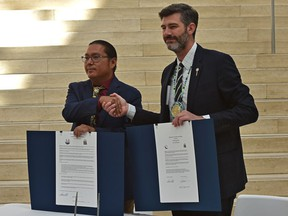 Mayor Don Iveson, right, and Grand Chief Okimaw Vernon Watchmaker during a signing ceremony for a memorandum of cooperation and dialogue at Edmonton City Hall on Wednesday, Sept. 15, 2021.