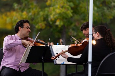 The Vaughan String Quartet, comprised of Vladimir Rufino on violin, Mattia Berrini on violin, Fabiola Amorim on viola and Silvia Buttiglione on cello (not shown), perform an outdoor concert at Festival Place in Sherwood Park, on Friday, Sept. 24, 2021.