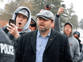 Artur Pawlowski, along with supporters, confronts police at his Calgary church, May 8, 2021. Pawlowski was leading a rally against COVID-19 restrictions.