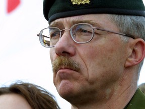 """Four Canadian soldiers from Edmonton Garrison were killed in Afghanistan by """"friendly fire. """" Brig. Gen. Ivan Fenton of Edmonton Garrison speaks at a media conference in Edmonton on April 18, 2002, as a Canadian flag flies at half staff in the background."""