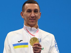 Tokyo 2020 Paralympic gold medalist Denys Dubrov of Ukraine celebrates on the podium, August 28, 2021.