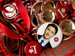 Campaign buttons, including one of Justin Trudeau, sit in a basket at Edmonton Centre Liberal candidate Randy Boissonnault's campaign office, Monday Sept. 20, 2021.