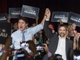 Prime Minister Justin Trudeau celebrates with Steven Guilbeault during an event to launch his candidacy for the Liberals in Montreal on Wednesday, July 10, 2019.