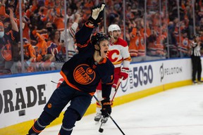 Edmonton Oilers' Jesse Puljujarvi (13) celebrates a goal on Calgary Flames goaltender Jacob Markstrom (25) during third period NHL action at Rogers Place in Edmonton, on Saturday, Oct. 16, 2021.