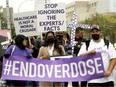 Participants in International Overdose Awareness Day march through Edmonton on Aug. 31, 2021.