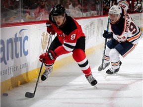 Taylor Hall #9 of the New Jersey Devils takes the puck as Ryan Nugent-Hopkins #93 of the Edmonton Oilers defends in the second period on November 9, 2017 at Prudential Center in Newark, New Jersey.