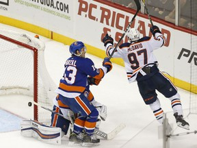 Edmonton Oilers captain Connor McDavid celebrates after scoring the winning goal in overtime  of an NHL hockey game against the New York Islanders in Brooklyn, N.Y., on Nov. 7, 2017.