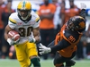 Edmonton Eskimos' John White, left, gets away from B.C. Lions' Mic'hael Brooks during the first half of a CFL football game in Vancouver, B.C., on Saturday, June 24, 2017. THE CANADIAN PRESS/Darryl Dyck ORG XMIT: VCRD208