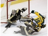 University of Alberta Pandas' Alexandra Poznikoff (16) is dragged down by the Manitoba Bisons' Megan Neduzak (6) in front of goaltender Rachel Dyck (56) during second period Canada West action at Clare Drake Arena in Edmonton Friday, Jan. 5, 2018. Neduzak received a holding penalty on the play. Photo by David Bloom