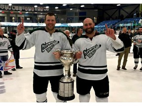 Matt Sefanishion, right, poses with Grand Falls-Windsor Cataracts teammate Derick Martin after the club claimed the 2017 Allan Cup in Bouctouche, N.B. The best senior amateur men's hockey teams from across Canada have competed for the Allan Cup every year since 1909, except for 1945, when play was suspended during the war effort. (File)