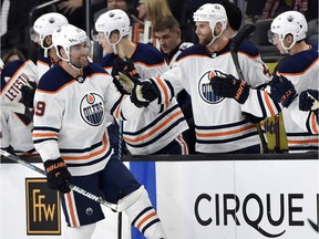 Edmonton Oilers winger Patrick Maroon  celebrates with his teammates after scoring a goal against the Vegas Golden Knights on Jan. 13, 2018, during NHL action in Las Vegas.