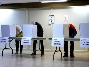 Voters cast ballots in a municipal election.