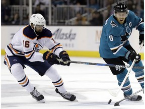 San Jose Sharks' Joe Pavelski, right, skates in front of Edmonton Oilers' Jujhar Khaira during the second period of an NHL hockey game Tuesday, Feb. 27, 2018, in San Jose, Calif.