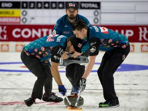 Team North America skip Reid Carruthers of Winnipeg, lead Colin Hodgson,second Derek Samagalski, brush the stone during a match against Team World at the 2017 Continental Cup