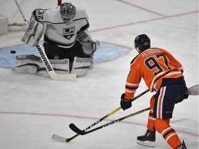 Edmonton Oilers Connor McDavid (97) scores his second goal on Los Angeles Kings goalie Jonathan Quick during second period NHL action at Rogers Place in  Edmonton, March 24, 2018.