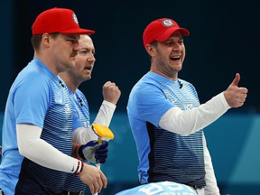 Matt Hamilton, George Tyler, John Shuster, John Landsteiner of USA celebrate after beating Canada during the PyeongChang Olympicd at Gangneung Curling Centre on February 22, 2018 in Gangneung, South Korea. (Dean Mouhtaropoulos/Getty Images)
