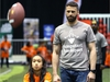 Edmonton Eskimos quarterback Mike Reilly watches students throw and catch during a Jumpstart event at the RBC Convention Centre that is part of CFL Week in Winnipeg on Thurs., March 22, 2018. Over 150 kids from Greenway and Victory schools were able to participate in drills with current CFL stars. Kevin King/Winnipeg Sun/Postmedia Network