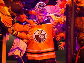Goalie Cam Talbot is welcomed to the ice by fans as he prepares to take part in the Edmonton Oilers skills competition on Feb. 3, 2018 in Edmonton.