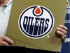 Oilers Entertainment Group CEO Bob Nicholson holds up a NHL draft card as he speaks about the Edmonton Oilers winning the draft lottery and potentially selecting top prospect Connor McDavid during a press conference held at Rexall Place in Edmonton, Alta., on Monday April 20, 2015. Ian Kucerak/Edmonton Sun/Postmedia Network